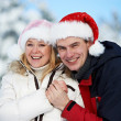 Happy family couple in winter — Stock Photo