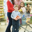 Stock Photo: Family with children shopping fruits