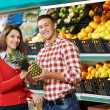 Family with child shopping fruits — Stock Photo #36834015
