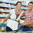 Family at food shopping in supermarket — Stock Photo #36834035