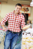 Man at supermarket dairy shopping — Stock Photo