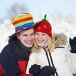Happy family couple in winter — Stock fotografie #36876801