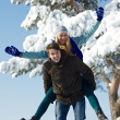 Young couple in winter — Stock Photo #36876825