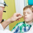 Little boy at ear nose thoat doctor — Stock Photo