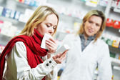 Ill patient in pharmacy drug — Stock Photo
