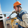 Worker builders at facade tile installation — Stock Photo #37051413