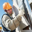 Builder at aerated facade tile installation — Stock Photo #37051445