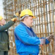 Stock Photo: Two construction workers making reinforcement