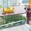 Workers installing glass window on building — Stock Photo #37052863