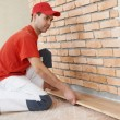 carpenter worker joining parket floor — Stock Photo