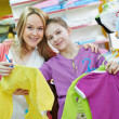 Woman and little girl shopping clothes — Stock Photo #37553323