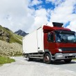 Lorry with trailer driving mountain road — Stock Photo