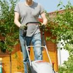 Man mowing lawn in backyard — Stock Photo #37553483