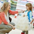 Woman and little girl shopping clothes — Stock Photo #37553563