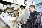 Worker operating metal machining center — Stock Photo