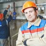 Heating engineer repairman in boiler room — Stock Photo #41160621