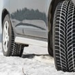 Winter tyres wheels installed on suv car outdoors — Stock Photo #41163405