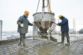 Construction workers pouring concrete in form — Stock Photo