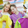 Woman and little girl shopping clothes — Stock Photo #42220359