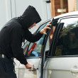 Thief burglar at automobile car stealing — Stock Photo