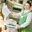 Saleswoman in supermarket shop — Stock Photo #42220553