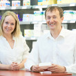 Foto de Stock  : Pharmacy chemist workers in drugstore