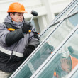 Worker installing window — Stock Photo