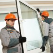 Two workers installing window — Stock Photo