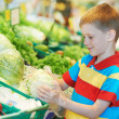Stock Photo: Child shopping at supermarket