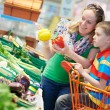 Family shopping at supermarket — Stock Photo #42221231