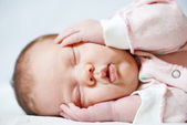 Sleeping newborn baby — Stock Photo