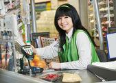 Shopping. Cashdesk worker in supermarket — Stock Photo