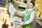 Saleswoman in supermarket shop — Foto Stock