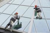 Two workers installing outside window — Stock Photo