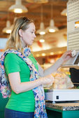 Young woman at food shopping in supermarket — Stock Photo