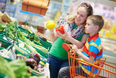 Family shopping at supermarket — Stock Photo