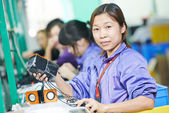 Chinese female worker at manufacturing — Stock Photo