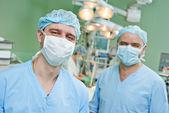 Smiling surgeons team at cardiac surgery operation — Stock Photo