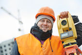 Portrait of surveyor worker with theodolite — Stock Photo