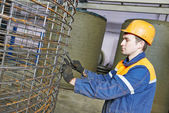 Worker making reinforcement for pipe — Stock Photo