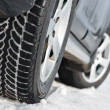Winter tyres wheels installed on suv car outdoors — Stock fotografie