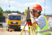 Surveyor worker with theodolite — Stock Photo