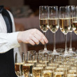 Waiter with glass of champagne — Stock Photo