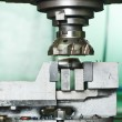 Close-up process of metal machining by mill — Stock Photo