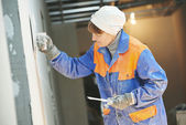 Plasterer at indoor wall work — Foto Stock