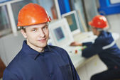 Happy industry worker at factory — Stock Photo