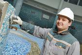 Tilers at industrial floor tiling renovation — Stock Photo