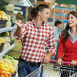 Family at food shopping in supermarket — Stock Photo #43254661
