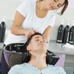 Man hair washing in hairdressing salon — Stock Photo #43255909