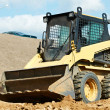Skid steer loader at earth moving works — Stock Photo #43256287